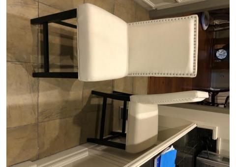 2 white upholstered barstools